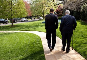President Barack Obama and Sen. Ted Kennedy walk on the grounds of the White House, before signing of the Kennedy Service Act at the SEED School in Washington, D.C., April 21, 2009. (White House/Pete Souza)
